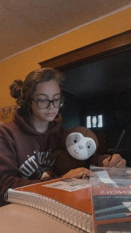 "Sophomore Trinity Reedy shows off her coloring skills accompanied by her stuffed sloth, Barbecue Sauce. Trinity said, ""With the quarantine driving me insane, coloring with a stuffed sloth is one of my best options."""