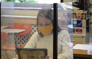 Sophomore Zowie Zokuskie, sits comfortably at her desk in a casual manner, due to the temporarily changed dress code.
