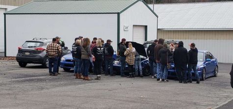 "Family and friends gather around Mike's car (middle) surrounded by the other two cars that belong to his best friends. Cars were something Mike was very passionate about. Lexi Platchko (not pictured) said, ""I thought the event was very nice because it included some of Mike's favorite things."""