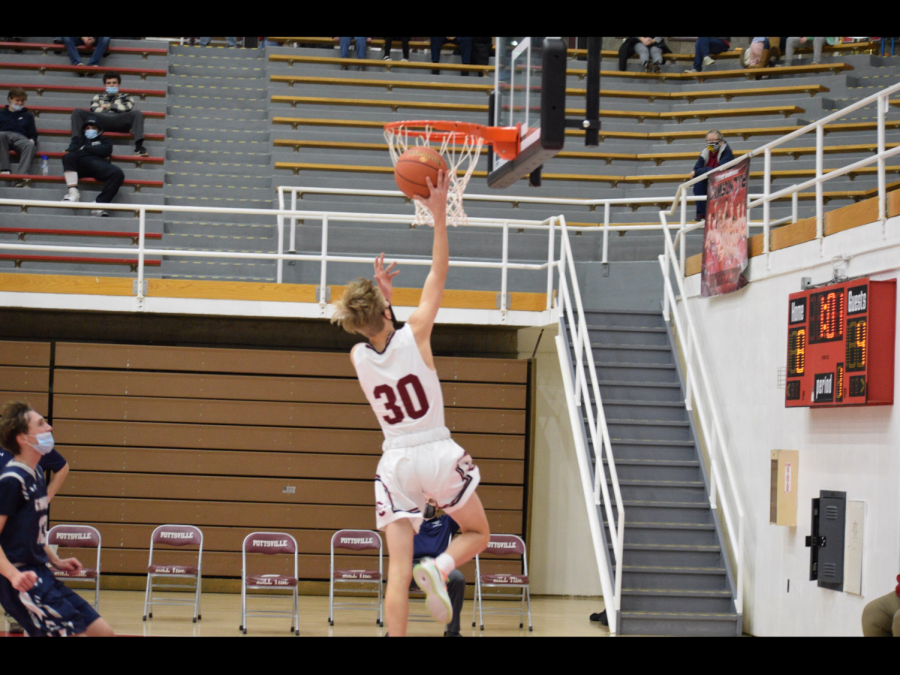 """Sophomore Rylen Matlock plays his game against Tamaqua for JV. Matlock has been playing basketball since the third grade. Matlock says, """"For the new year, I want to develop more basketball skills that will help me be the best I could."""""""