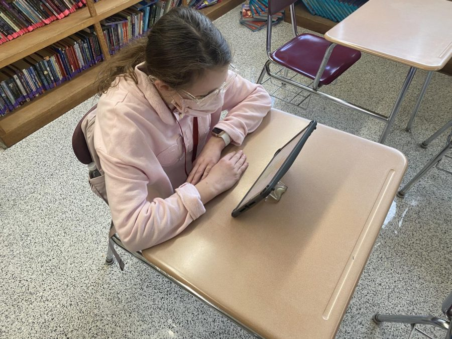 TEST+-+6th+grader+Emma+Sophy+works+on+her+iPad+during+one+of+her+in-person+school+days.+She+is+taking+a+test+on+Pearson+Realize%2C+an+online+program+that+is+used+at+DHHL.