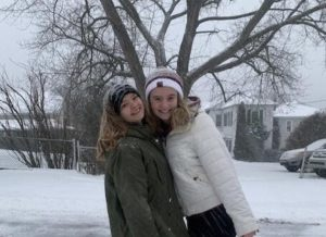 """Junior Emilee Rose and senior Greta Snukis take a winter weather photo. On December 16, 2020, students had a day to spend outside enjoying the snow. Junior Emilee Rose said, """"I enjoy snow days because watching the snow fall is very pretty."""""""