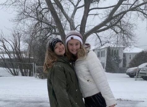 "Junior Emilee Rose and senior Greta Snukis take a winter weather photo. On December 16, 2020, students had a day to spend outside enjoying the snow. Junior Emilee Rose said, ""I enjoy snow days because watching the snow fall is very pretty."""