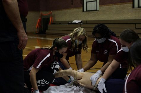 "Students in the EMT class do hands-on work such as performing CPR on a dummy. The class can make someone certified in CPR and can also lead to a future in the medical field. Senior Jamilah Philip-Johnson said, ""Being in the EMT course is different from any class I've had before. The beginning of the year was mainly learning from book, which was important since we need to know specific terms. Now that we are nearing the end of the year, we have way more hands-on learning. We also have after school sessions that show us exactly what to do for various situations. Unlike other teachers Mr.Moran is able to show us exactly how he works as an emergency medical technician"""