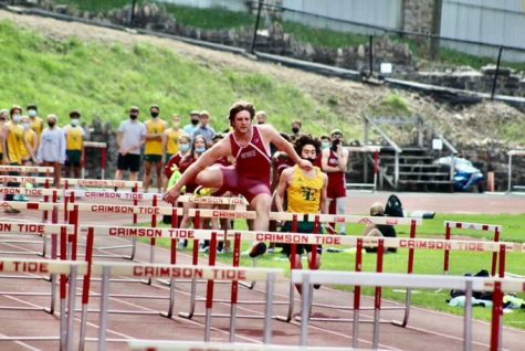 """Senior Bobby Walchak is in action during the 300m intermediate hurdles. Walchak and the other seniors had their senior night on April 19th. Bobby said, """"This year I ran the 110m high hurdles, 100m dash, 300m intermediate hurdles, threw javelin and did long jump. Track helped me for football by giving me a good workout, and also helped me with my 40 yard dash for football."""""""