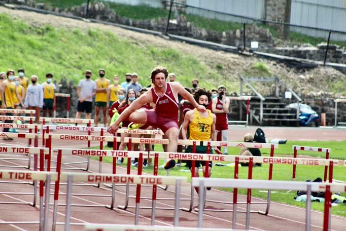 Senior+Bobby+Walchak+is+in+action+during+the+300m+intermediate+hurdles.+Walchak+and+the+other+seniors+had+their+senior+night+on+April+19th.+Bobby+said%2C+%E2%80%9CThis+year+I+ran+the+110m+high+hurdles%2C+100m+dash%2C+300m+intermediate+hurdles%2C+threw+javelin+and+did+long+jump.+Track+helped+me+for+football+by+giving+me+a+good+workout%2C+and+also+helped+me+with+my+40+yard+dash+for+football.%E2%80%9D+