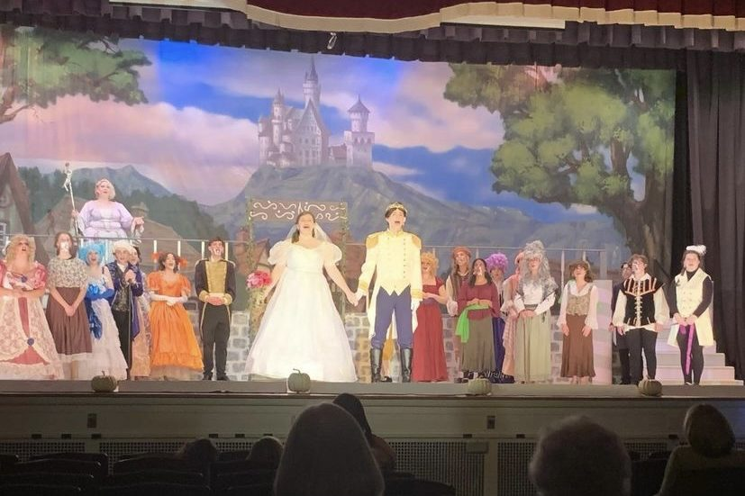"""The cast of Cinderella stands proud during the closing scene of the musical. It was held in the PAHS auditorium on April 23, April 24, and April 25. """"Our students really give their heart and souls to this performance. There was an added level of precautions to worry about with the pandemic, and honestly, I went into the season expecting it to be very different. However, despite low numbers of cast, crew. and put, this whole company was committed to excellence and Cinderella has been one of the most beautiful productions we have ever done, I am so very proud and eternally grateful,"""" said drama director Maria Malek."""