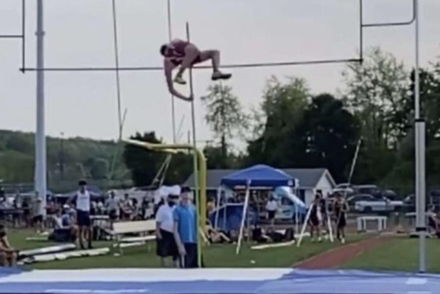 """Senior Billy McGowan pole vaults through the air. AAA took place on Wednesday, May 18 2021. Mrs. Lombel says, """" Being in the AAA class is always tough, but we had impressive performances this season and at District Championships. The teams in AAA are always great competition and you know you are competing against some of the best athletes."""""""