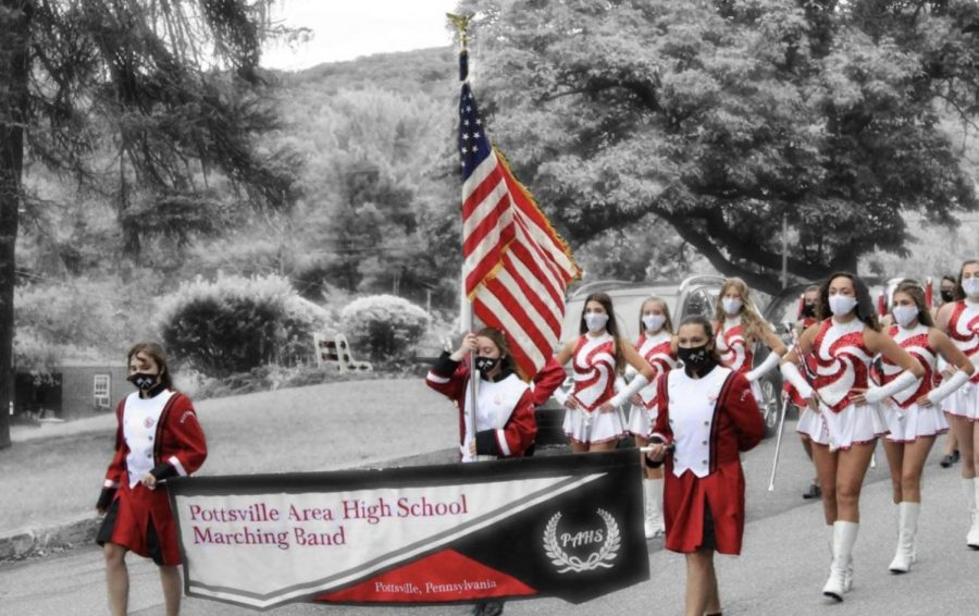 """Many people in PAHS are members of the Marching Band. Before a game the band practices their routines at the middle school and then they march up to the high school stadium. """"As the next twirling season is coming up, we are continuing to practice and are learning new combinations,""""said sophomore majorette, Chloe Heintz."""