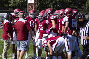 Tide coaches talk to players on the sideline during a game in September of 2020.