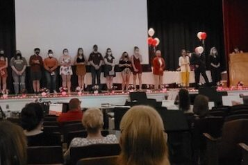 "Senior band members stand on the stage as they are receiving their gift. This year they were given portable chargers with ""PAHS 2021"" on it. Senior Jake Montgomery comments on the event saying, ""We did a nice farewell video and award ceremony for all the seniors."""