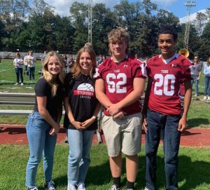 """PAHS Students enjoy an outdoor pep-rally. They are all taking advantage of the relaxed dress code to keep them from getting too hot in the heat outdoors. """"I like the relaxed dress code because for events like theses they keep everyone comfortable"""", said senior Faith Eckley."""